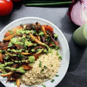 Peruvian Lomo Saltado with Cilantro Aji Sauce and Brown Rice