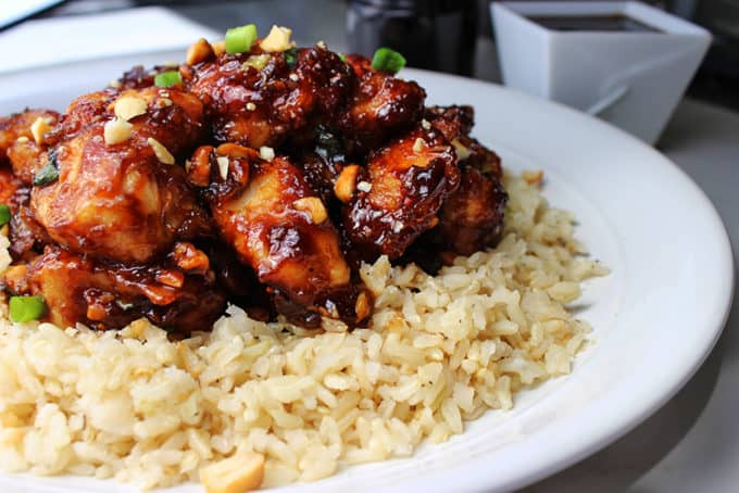 Spicy Cashew Chicken - Spicy, sweet, crispy & crunchy, this dish is everything you could hope for and more in a chicken dish. Straight from the restaurant's menu, this is a really spicy Mandarin-Style chicken dish with scallions and roasted cashews.
