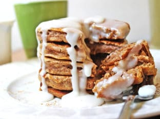 Fluffy, delicious pancakes that are easy to make and taste just like a cinnamon roll. With an icing similar to a cinnamon roll, you'll revel in the extra two hours of sleep you get when you're enjoying these with your morning cup of coffee!