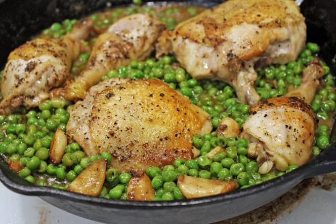 Crispy skinned chicken in a luscious white wine sauce with caramelized garlic and green peas. This is a one pot stove-top meal your family is going to absolutely love!