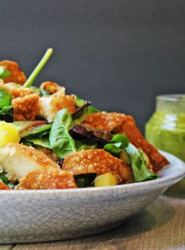 Tropical Macadamia Crusted Chicken on a salad with a Pineapple Jalapeno Vinaigrette and Crispy Wontons. A light summer meal, reminiscent of salads you may eat on a tropical vacation!