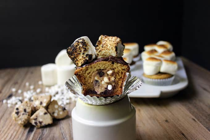 S'mores Cookie Dough Cupcakes - filled with Eggless S'mores Cookie Dough, a Graham Cracker Cake, Chocolate Ganache, and Toasted Marshmallow on top. Summer in a cupcake!