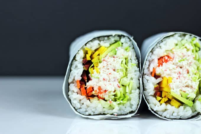 Try the trend taking over the Bay Area in California! Sushi gets supersized with an imitation crab meat sushi burrito that is filled with imitation crab, cucumber, avocado, carrots and napa cabbage. Serve with spicy mayo, and soy sauce and laugh at all the normal sized california rolls people are still eating.
