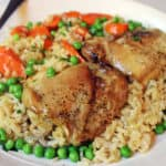 One pan easy baked Chicken Brown Rice Casserole served with Carrots and Peas. Healthy, flavorful and almost no clean-up involved!