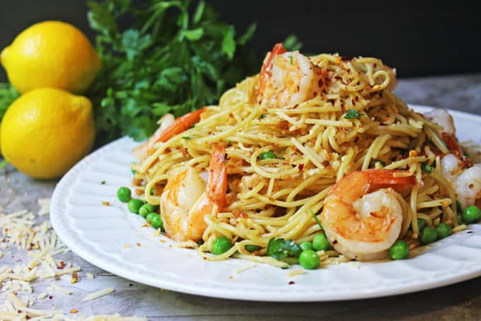 Crispy Shrimp Scampi Pasta with Parmesan & Peas. A deliciously crispy, spicy, cheesy and buttery shrimp pasta dish that elevates a shrimp scampi to a higher level with buttery crispy crackers instead of a panko crust. Perfect with a glass of white wine and a light salad.