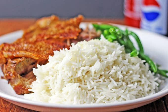 Easy light coconut rice dinner then dessert dress up your regular rice with coconut milk to make a delicious side dish for your forumfinder Images
