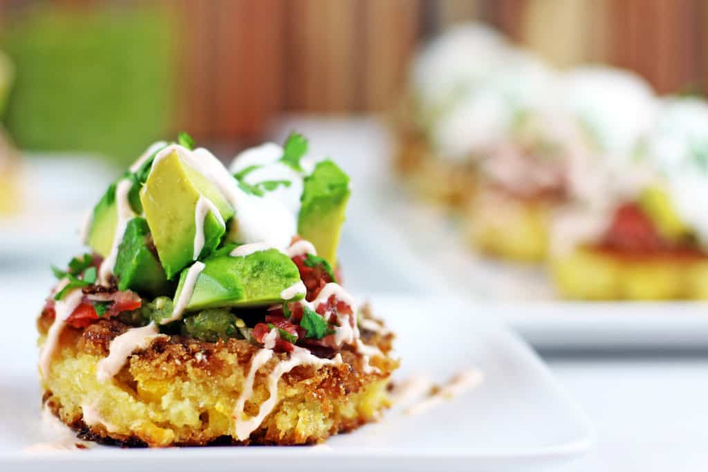 Cheesecake Factory Corn Cakes are tender, buttery corn cakes topped with tomatillo salsa, pico de gallo, southwestern sauce, avocados, cilantro and sour cream! A Cheesecake Factory favorite brought into your own kitchen.