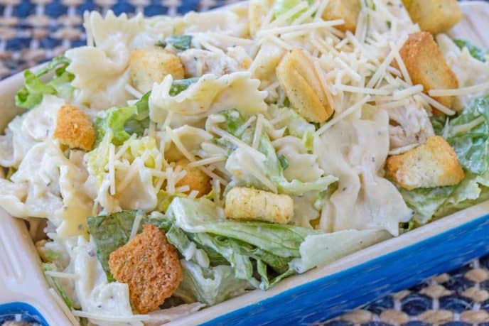 chicken caesar pasta salad in blue serving dish