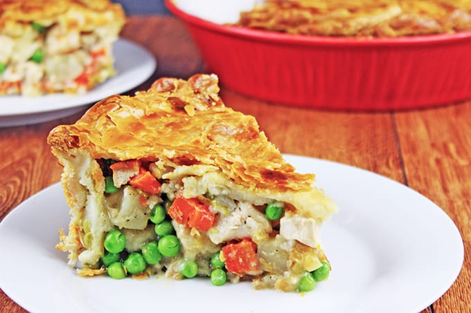 Full of grilled chicken, caramelized carrots, potatoes, celery with a delicious homemade creamy chicken sauce (with no cans of soup!), it is baked inside a delicious pie crust for a fantastic dinner that will be enjoyed by all!