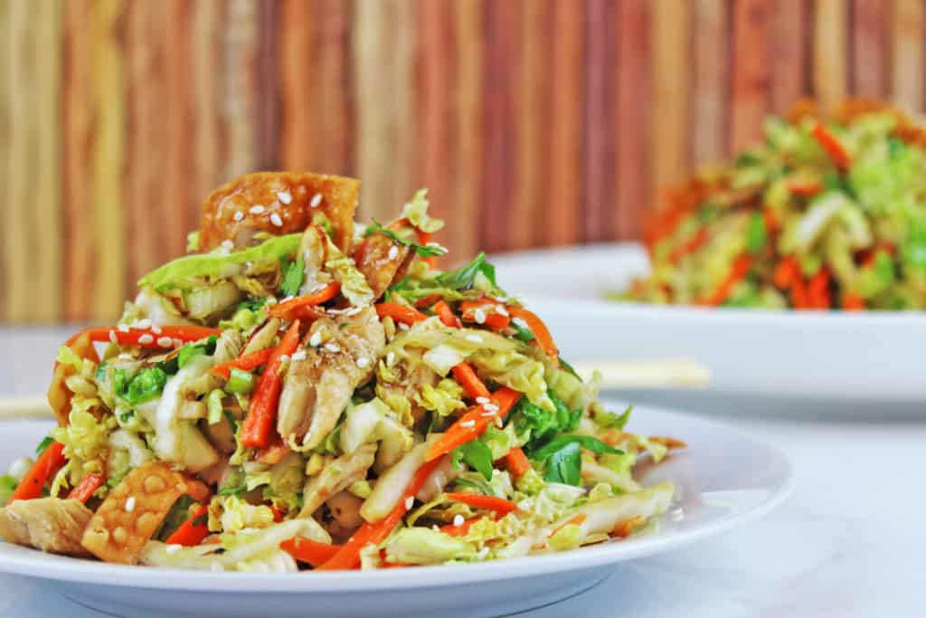 Chinese Salad with cabbage and carrots on white serving plate