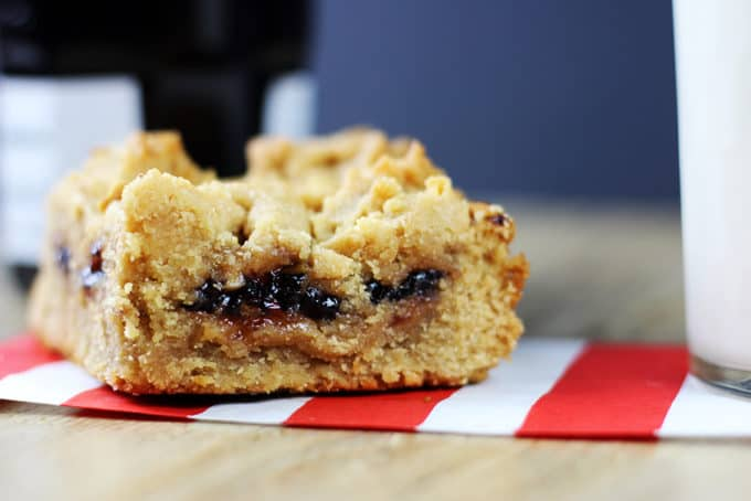Peanut Butter & Strawberry Jelly Bars taste like a cross between a moist peanut butter cookie and a delicious PB&J sandwich. The top is crispy while the bottom layer stays cakey and fudgy! All the comfort of your favorite cookie and sandwich in one.
