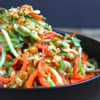A fresh, crunchy Asian Lime-Peanut Slaw with fresh cucumbers, carrots and bell peppers. Seasoned with sesame oil, lime juice and peanut butter this dish will make your friends and family think you're a rockstar in the kitchen!