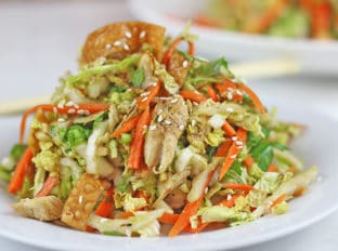Chinese salad heaped onto white plate