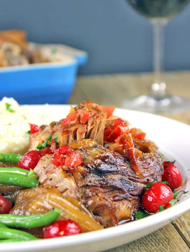 Spicy & Sweet this pork is roasted over onions with chipotle peppers and cherry flavored pop along with some fun maraschino cherries until fork tender. Perfect meal for a main course, tacos, on top of nachos!
