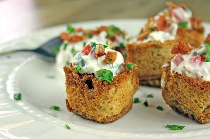 These little BLT bites are full of your favorite Bacon, Lettuce & Tomato Sandwich flavors in a small crispy bread cup. Made with cream cheese, sour cream, tomatoes, bacon and parsley, they are a fantastic holiday or football party food!