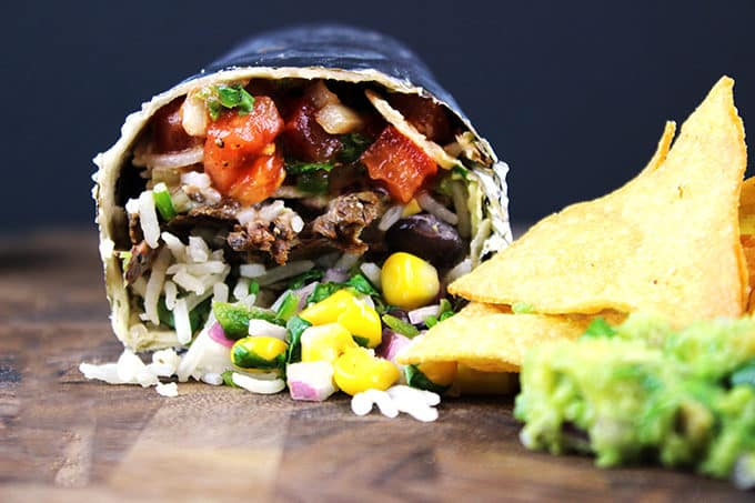 Spicy, seasoned beef cooked low and slow to tender perfection! Your favorite Mexican take out! You'll love this amazingly easy copycat version of the famous Chipotle Barbacoa Beef Burrito so you can feed a large crowd and save 80% the price!