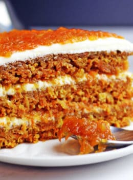 Luscious (nut free) carrot cake made with pineapple and filled with homemade carrot cake jam and cream cheese frosting. Instructions included for making extra layers too. This is the ultimate in carrot cakes and a perfect holiday dessert!