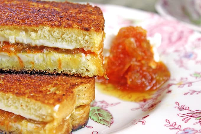 Carrot Cake Grilled Cheese Sandwiches made with homemade Carrot Cake Jam, cream cheese and buttery griddled bread! Cut into sticks or triangles for a fun kid friendly sandwich, or skip the butter and griddle and serve these up at your next tea party!