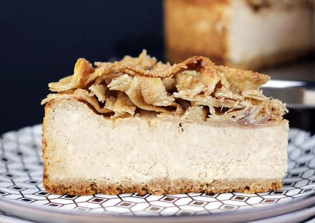 A tall, creamy, rich NY-Style Cinnamon Cheesecake topped with crispy, buttery, cinnamon sugar tortillas. This Cheesecake has it all, a rich taste with a hint of cinnamon spice topped with a crispy sweet crunch, it is a showstopper of a dessert!