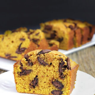 Slice of Chocolate Chip Pumpkin bread on white plate