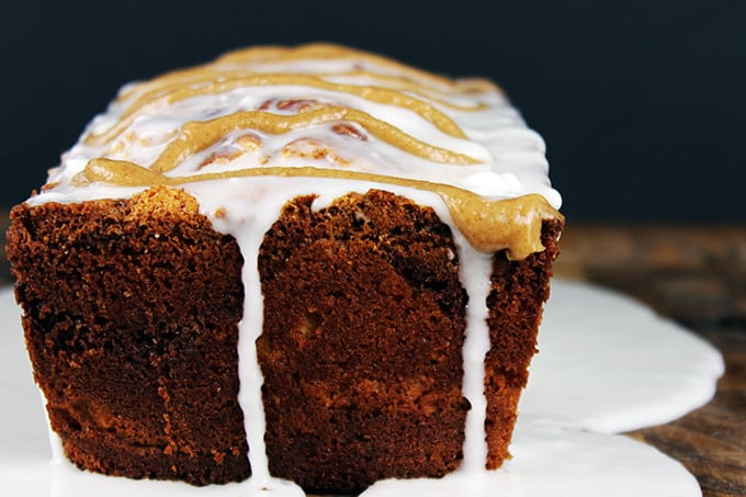 Tender, Rich Cinnamon Roll Pound Cake drenched in Cinnamon Swirl Icing. Easy to make, addicting to eat and perfect for your morning cup of coffee!