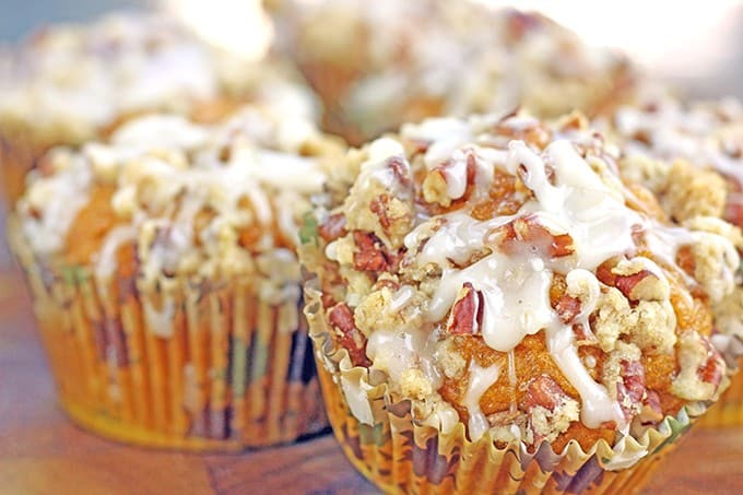 A delicious pumpkin muffin topped with a pecan streusel crunch and drizzled with a maple icing. It is all the amazing flavors of fall all rolled in to a delicious breakfast treat.