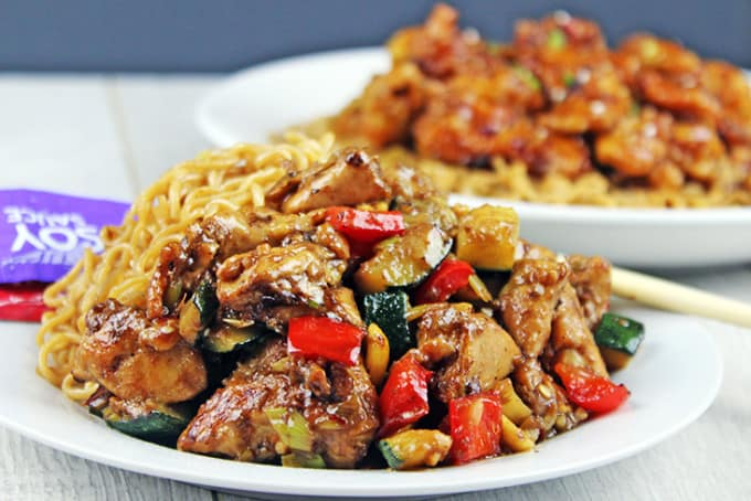 Full of Spicy Wok fired Chicken Breast, Zucchini, Red Bell Peppers and crunchy Peanuts in a Sesame Ginger-Garlic Sauce, this recipe is Authentically Panda Express! The recipe is straight from the source! http://archives.starbulletin.com/2007/01/17/features/story01.html BACK TO TOP art CRAIG T. KOJIMA / CKOJIMA@STARBULLETIN.COM Panda Express customer favorite Kung Pao Chicken. CLICK FOR LARGE Kung Pao Chicken is tasty, too No luck getting that Orange Chicken recipe, but Panda was willing to part with another of its top dishes. Kung Pao Chicken 1 pound boneless, skinless chicken breast, diced into 1/2-inch pieces, rinsed and drained 1 teaspoon cooking wine 2-1/2 tablespoons soy sauce 1/3 cup water 2-1/2 tablespoons vegetable oil, divided use 12 whole dry chili peppers (smaller than 3 inches; if longer, cut in half) 1/4 cup diced green onion, white part only, in 1/2-inch pieces 1 teaspoon ground ginger 1 teaspoon ground garlic 1 teaspoon crushed red chili pepper 1/2 tablespoon cornstarch mixed with 1/2 tablespoon water 1 teaspoon sesame oil 2 ounces dry roasted peanuts » Marinade: 1/4 cup water 1/2 teaspoon salt 1/2 egg 1/4 cup cornstarch 2 tablespoons vegetable oil Combine marinade ingredients. Add chicken; refrigerate at least 1 hour. Combine wine, soy sauce and water; set aside. Heat wok on high heat 10 seconds. Add 2 tablespoons oil and heat well. Remove chicken from marinade and add to wok. Stir-fry quickly, 60 seconds. Remove chicken; drain well. Add chili peppers. Stir-fry until they darken. If wok becomes too dry, add 1/2 tablespoon vegetable oil. Add green onions, ginger, garlic and crushed red chili pepper. Stir-fry 5 seconds. Return chicken to wok; stir soy sauce/wine mixture and add; stir until sauce boils, then add cornstarch mix to thicken. Add sesame oil and peanuts. Stir and fold until ingredients are thoroughly mixed. Serves 3.