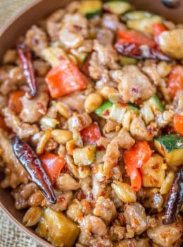 Panda Express Kung Pao Chicken is Full of spicy chicken, zucchini, red bell peppers and crunchy peanuts in an easy ginger garlic sauce, this recipe is authentically Panda Express!