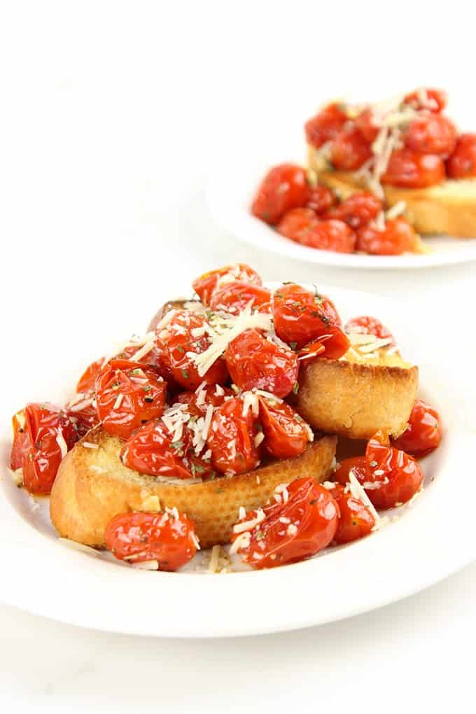 Hold on to those fleeting memories of summer with these amazing Roasted Garlic Tomatoes made in just 15 minutes and versatile enough to be an appetizer, part of a main course or a fantastic spread on a sandwich!