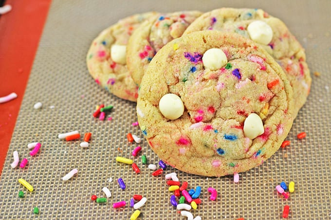 Chewy, crispy delicious cookies that taste like a delicious birthday cake covered in sprinkles! A perfect treat for a birthday lunch or a birthday party dessert table, these cookies will put a huge smile on your face.
