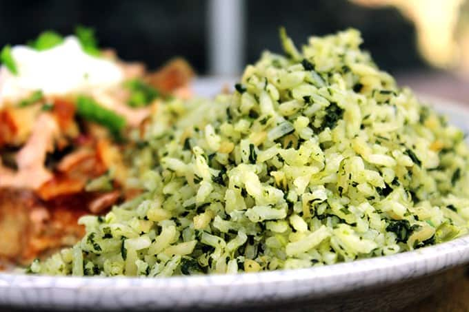 You'll feel like you've sat down to a meal in your favorite mexican restaurant with this slightly spicy Green Mexican Rice made with Cilantro, Jalapeno, Garlic, Spinach and chicken stock. 2 minutes in the extra prep added to your normal rice and you'll LOVE the added flavor!