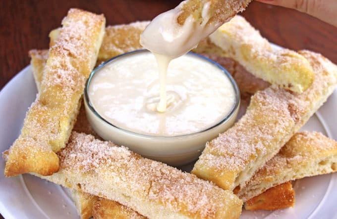 Sweet Cinnamon Stix (Pizza Sticks) like the ones from Domino's... but better because of real butter! and sweet vanilla dipping sauce make pizza night at home feel like you ordered out.