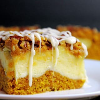 Delicious pumpkin bread with a layer of sweet cheesecake topped with crunchy pecans. Everything you could want in a Fall themed dessert and more. It's easy enough to remember the four ingredients and it works for when you don't need that super thick, rich cheesecake. The addition of the chopped pecans adds a crunchy element to the soft cake, and creamy cheesecake and icing layers.