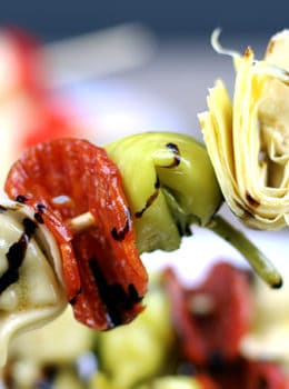 Italian Antipasto Skewers: The spice of the pepperoni, the sweet vinegar of the balsamic glaze, the tender tortellini filled with ricotta and spinach, the briney flavor of the pepperoncini and the artichoke heart. This skewer is going to be a solid contender for favorite bite at your next party!
