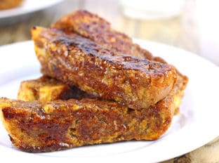 Brûléed Pumpkin French Toast Sticks. French bread soaked in a pumpkin egg custard flavored with cinnamon, nutmeg and vanilla is cooked on a griddle, then rolled in brown sugar and cooked a second time to caramelize the surface. Who needs syrup when you have crispy brown sugar on your French toast?