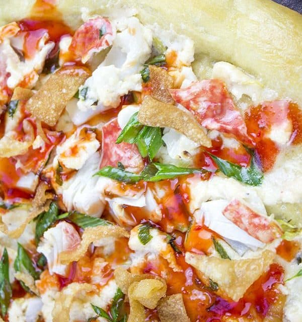 """This Crab Wonton Pizza with Sweet & Sour Drizzle is the answer to """"Pizza or Chinese?"""" and in the best possible way because you can make it at home! Crunchy, creamy, sweet and sour you'll find yourselves fighting over the last slice!"""