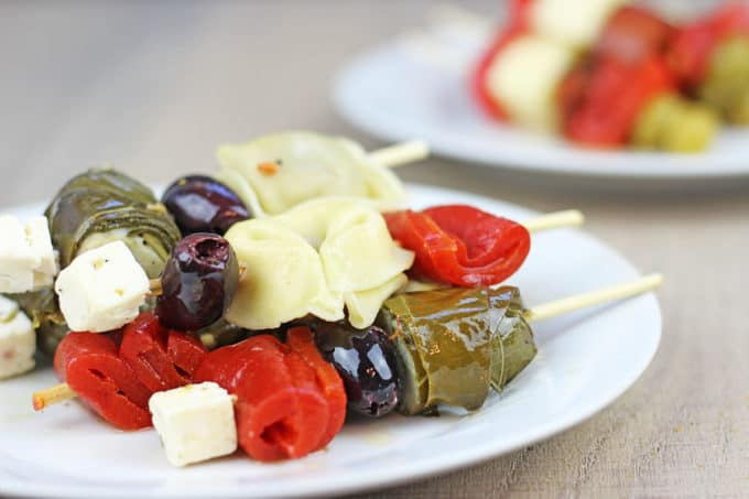 Your guests will love these cocktail party appetizers! Garlicky tortellini, stuffed grape leaves, feta, olives and peppers with almost no effort!