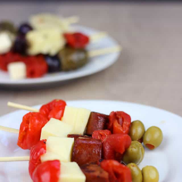Made with peppers, Manchego cheese and stuffed olives, these skewers come together in a matter of minutes! PLUS 3 ways to Roast Bell Peppers on your grill, your stovetop or your oven!
