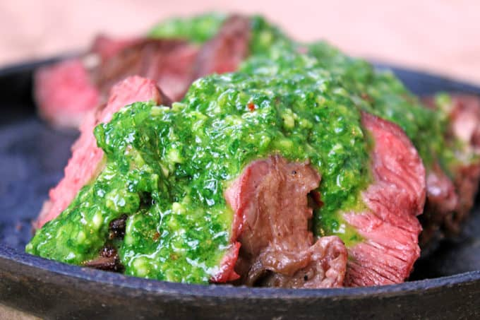 Cast iron ribeye covered in Chimichurri sauce