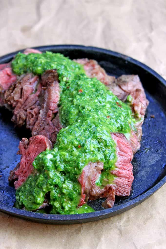 pan seared ribeye or cast iron ribeye covered in green ribeye sauce