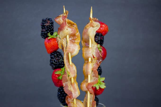 Bacon is threaded onto a soaked bamboo skewer and baked perfectly crisp in the oven while a mixed berry kabob is lightly flavored with a hint of sweetness, lemon and mint. Your brunch guests will LOVE these skewers.