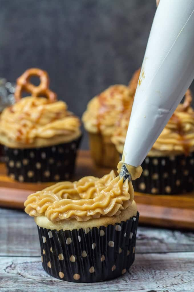 Gluten Free Salted Caramel Cupcakes are definitely for you. Homemade salted caramel sauce on top of a vanilla cupcake come together to form a sweet and buttery treat. These cakes are light, fluffy, and full of flavor. Best of all? They're gluten free!