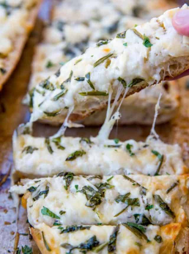 We LOVE this Spinach Artichoke Dip Cheesy Bread