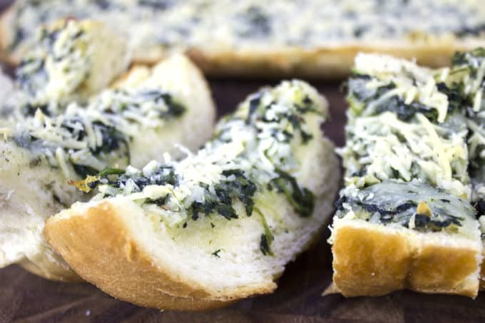 Spinach & Artichoke Dip Garlic Bread is two of your favorite appetizers in one. Cheesy garlic bread meets spinach and artichoke dip and it only takes 30 minutes until you're enjoying it!