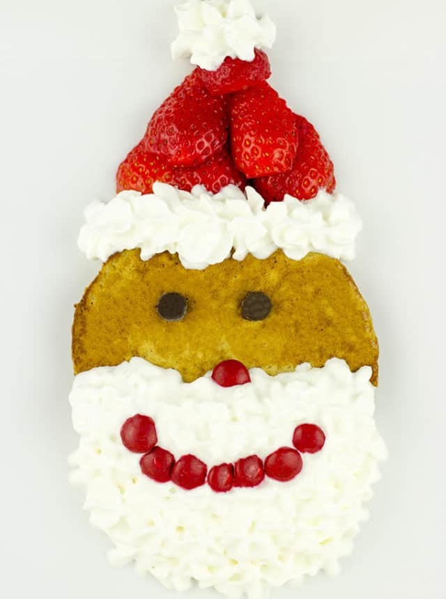 Delicious homemade Gingerbread Pancakes dressed up as Santa! Quick, easy, and so cute!