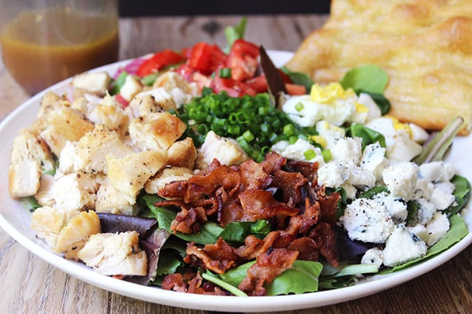 Cosi Cobb Salad with grilled chicken, bacon, eggs, gorgonzola and more topped with Cosi's signature Sherry Shallot Vinaigrette dressing.