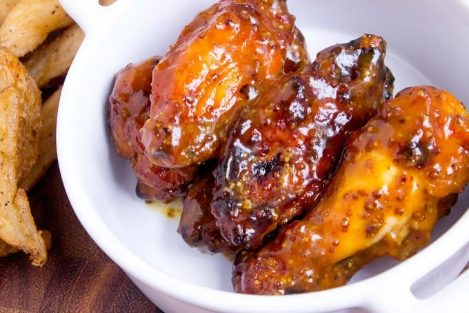 Tossed in a homemade honey mustard, these Honey Mustard BBQ Chicken Wings will be the hit of your game day party.