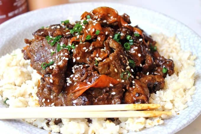 Spicy Tangerine Beef simmered in spicy garlic orange sauce with carrot ribbons. Tastes like a cross between orange beef and Mongolian beef!