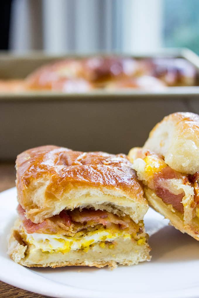Baked Bacon Egg and Cheese Hawaiian Sliders are quick to make. They're a perfect make ahead and bake the morning of option for get togethers and can quickly serve a crowd!
