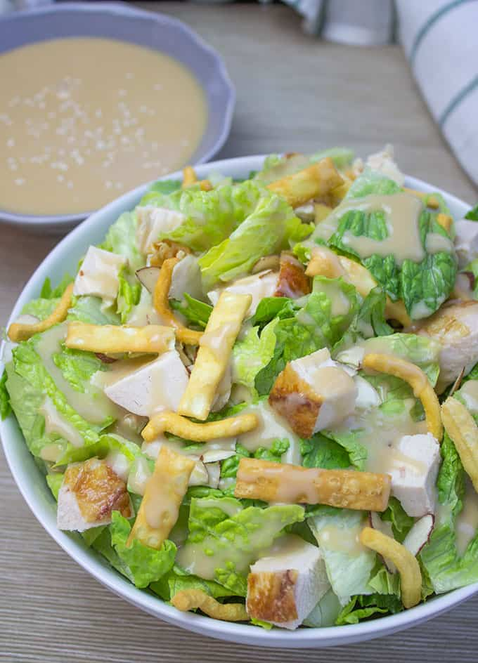All the flavors of the Costco Chinese Style Salad Kit without the 10$ price tag and the prepackaged chicken. Delicious honey miso dressing with chicken, almond and crispy toppings.